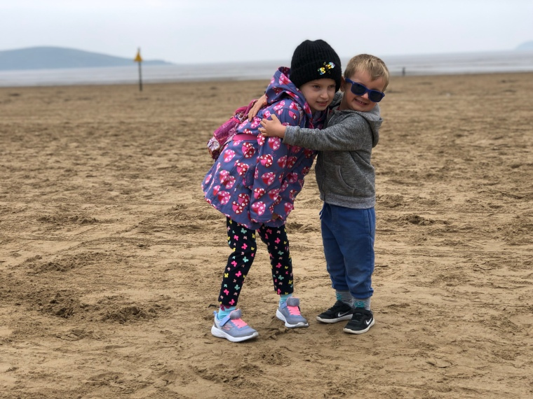 my kids hugging on the beach - A few hours in Weston-super-Mare
