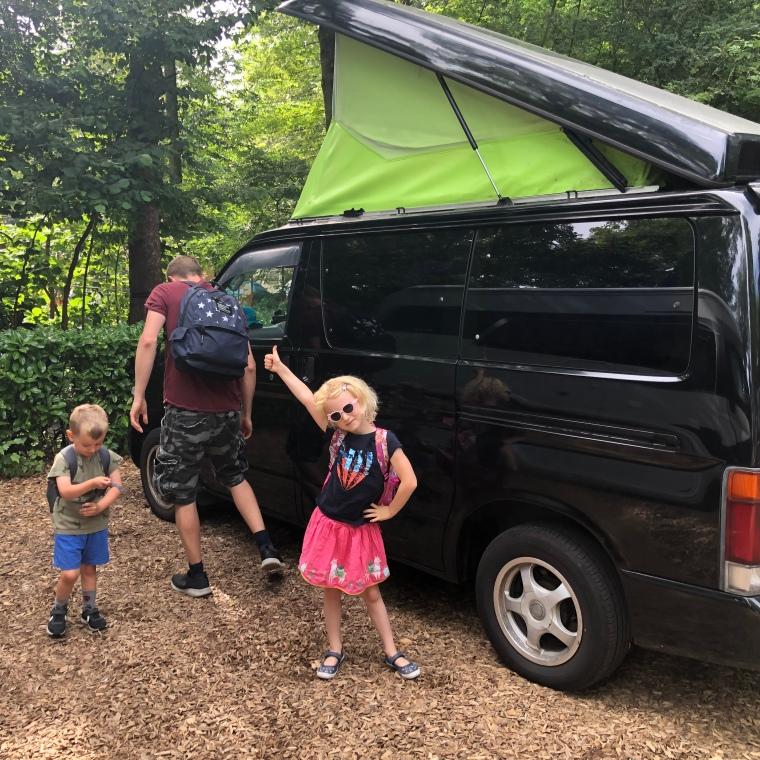 Mazda Bongo Black with Green Poptop family camping in Amsterdam