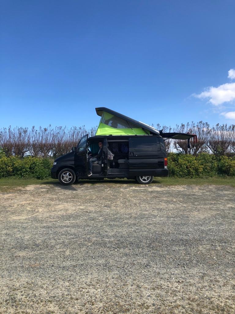 Bongo camper van black green pop top Harlyn Bay Cornwall