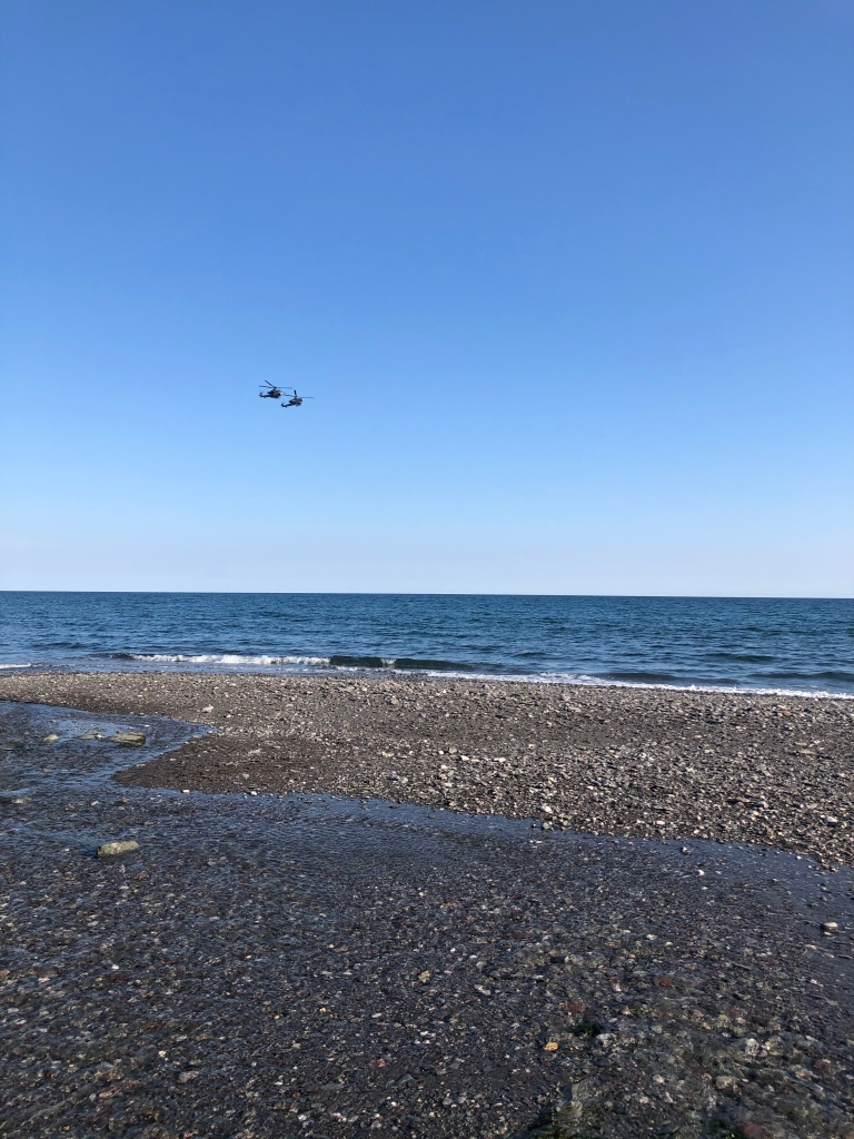 military helicopters flying over seaton beach cornwall
