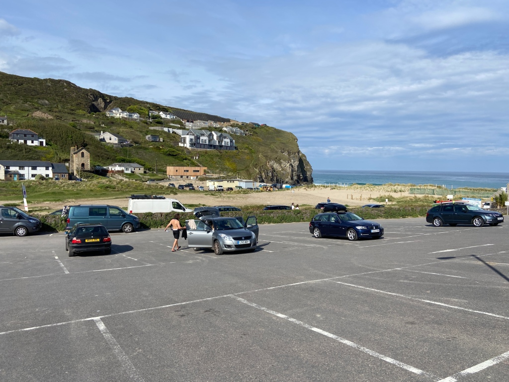 Houses on cliff and beach view from a carpark at Porthtowan beach in Cornwall