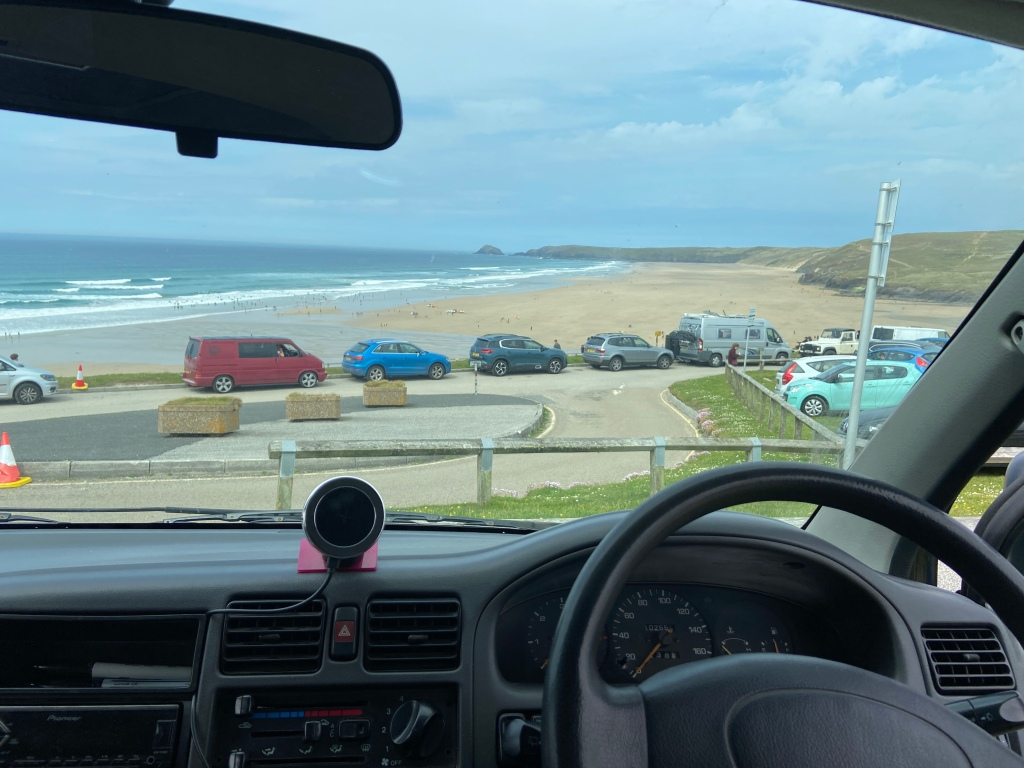 View of Perranporth beach in Cornwall from inside our campervan after parking nearby