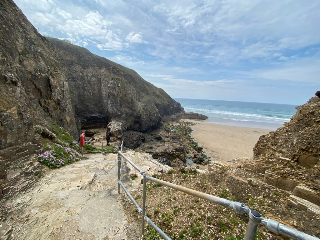 Cliff steps down to Perranporth beach in Cornwall