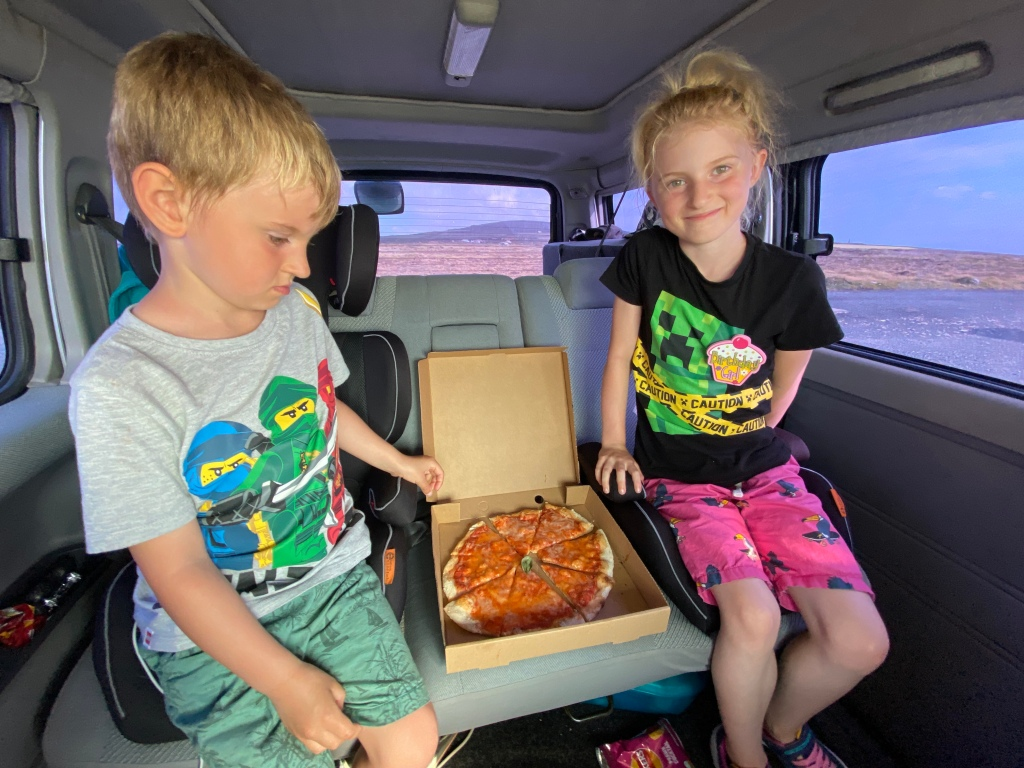 kids in bongo with vegan pizza from st agnes takeaway