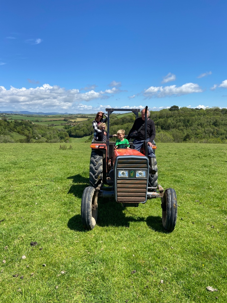 kid driving tractor West Portholland, Cornwall