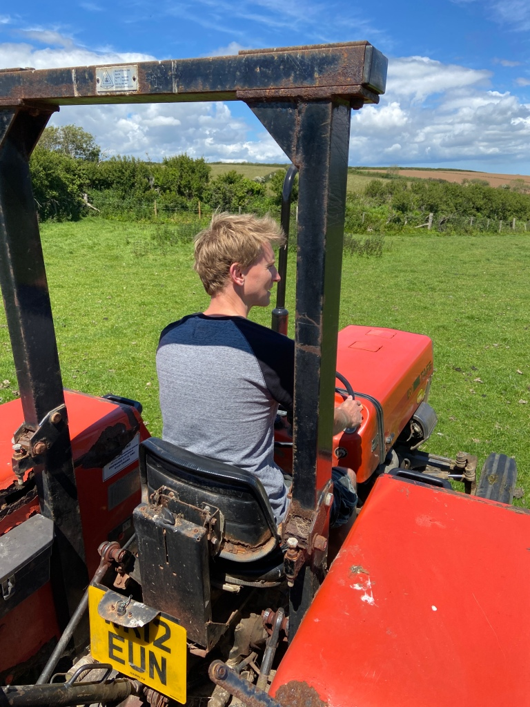 man driving tractor West Portholland, Cornwall