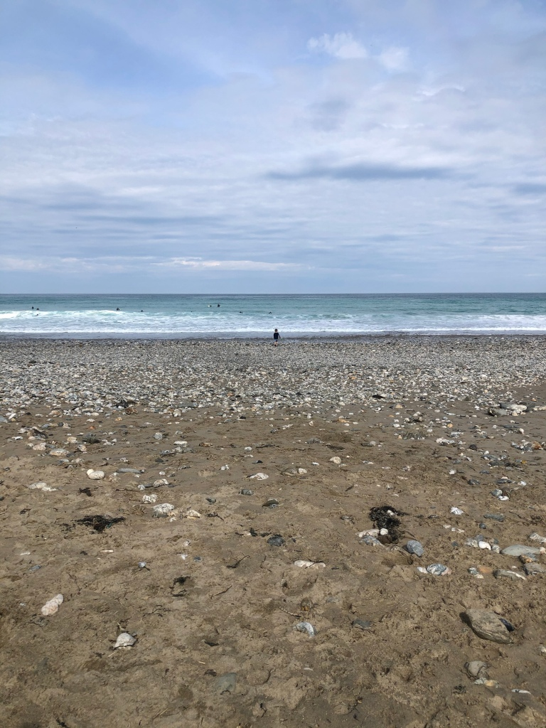 Reuben, our 6 year old, in the distance heading to the sea and waves at Porthtowan beach
