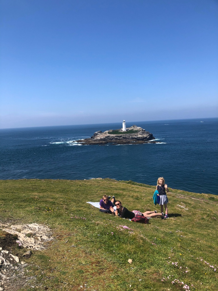 Sunbathing on the cliffs near Godrevy lighthouse in Cornwall
