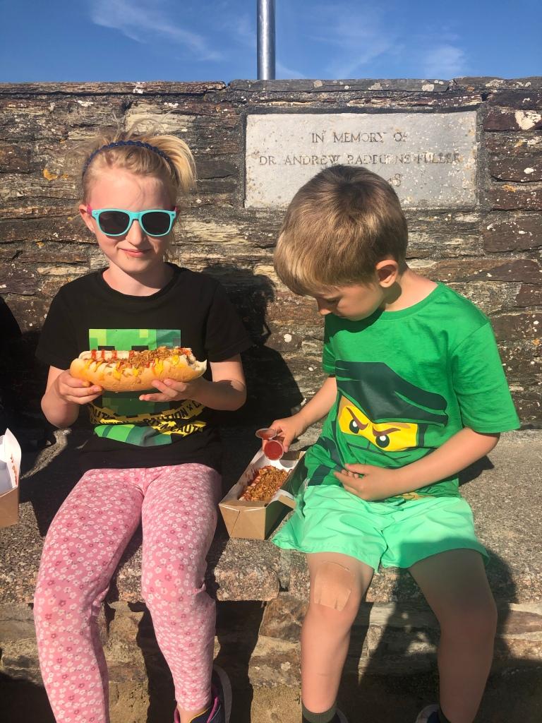 Eating vegan hotdogs in Perranporth